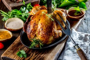 Roasted Chicken with Rosemary and Sauces on Wooden Board