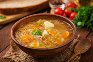 Traditional Russian soup with cabbage - sauerkraut soup.